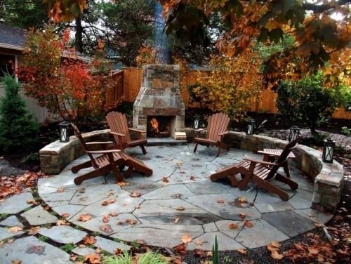 Round Flagstone Patio With Stone Fireplace