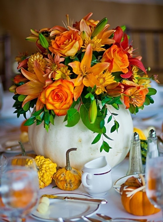Fall flowers in pumpkin vase pictures photos and images for Bouquet de fleurs halloween