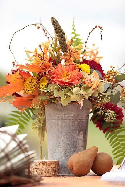 Bucket Filled With Leaves And Fall Flowers Pictures