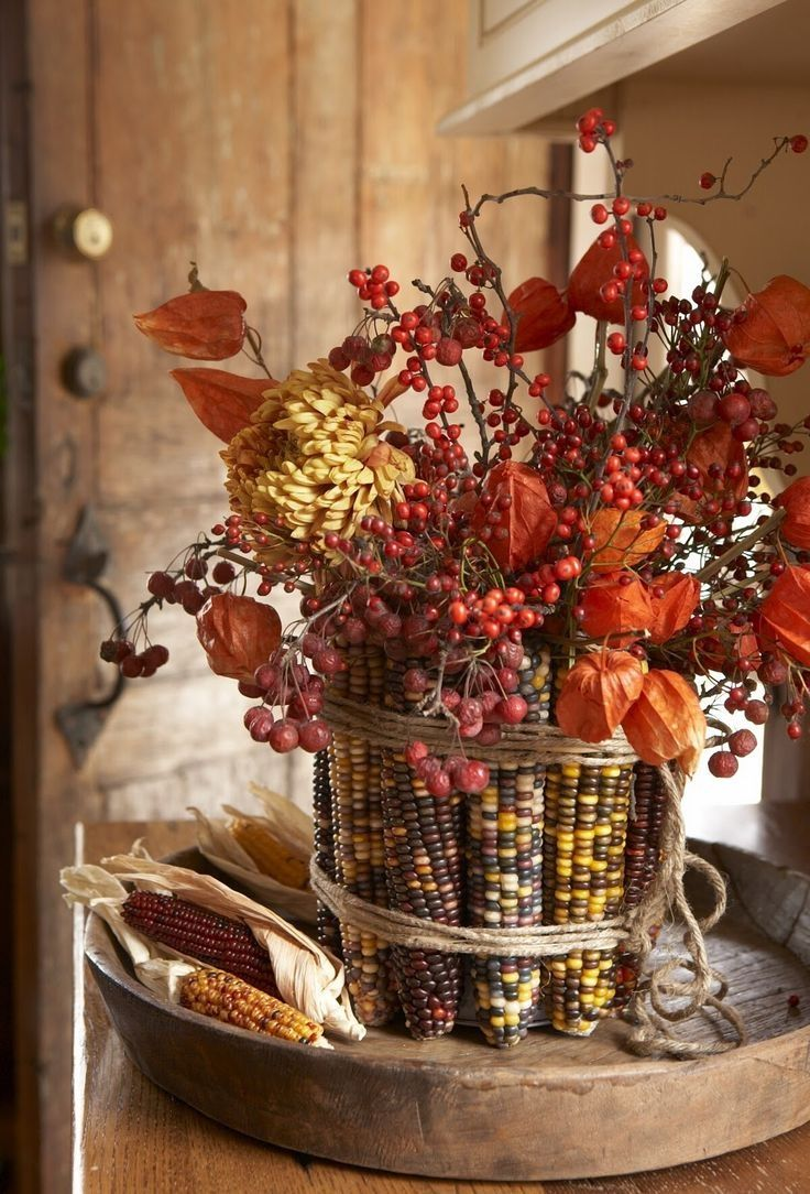 Dried flowers berries twigs wrapped in corn and