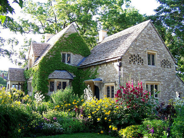 English Cottage With Ivy Bird Niches And Surrounded By An English