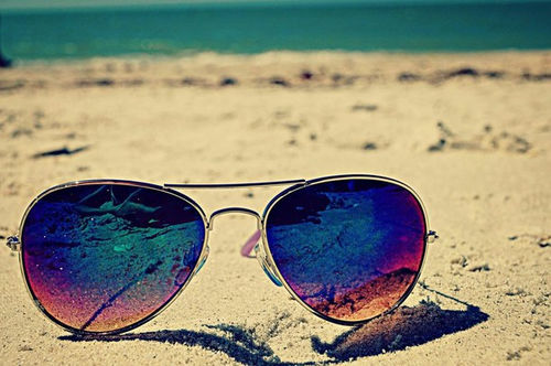 Image result for sunglasses in beach
