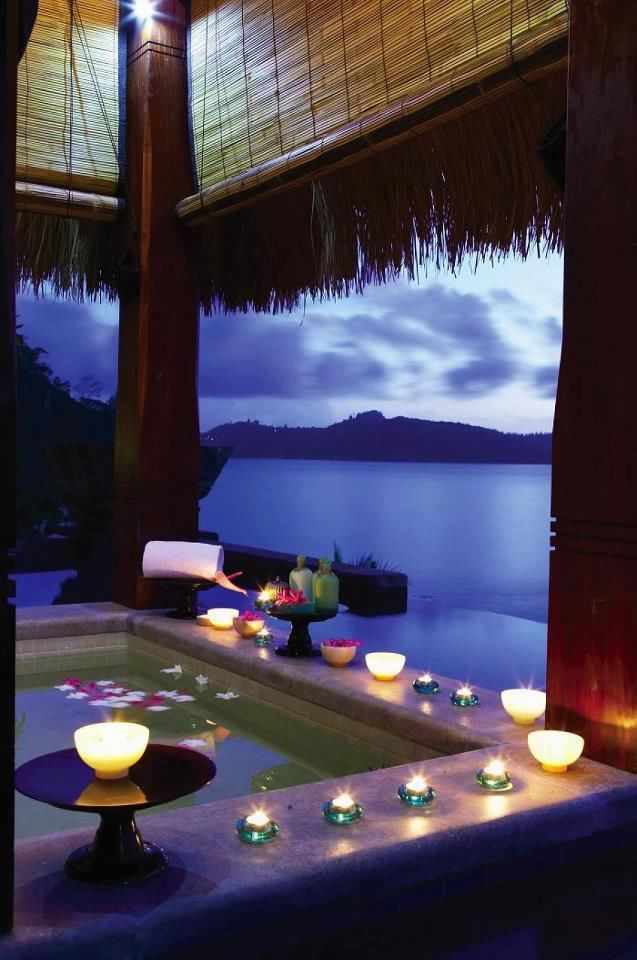 Romantic jacuzzi bath overlooking the ocean pictures for Bathroom romance photos