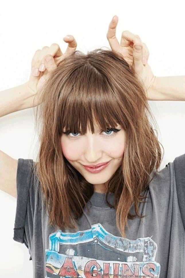 Cute Medium Haircut With Blunt Bangs Pictures Photos And Images