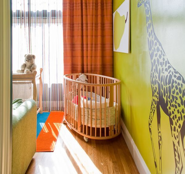 Colorful Baby Nursery Ideas With Round Crib And Orange