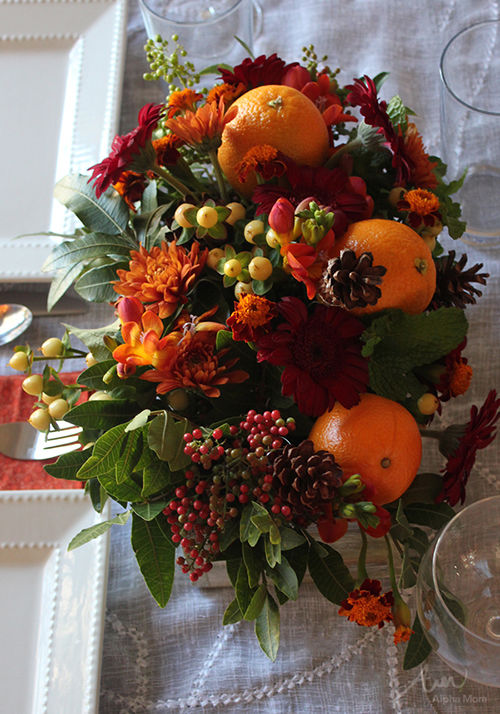 Thanksgiving centerpiece with oranges berries flowers