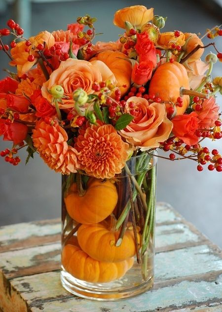 Thanksgiving Centerpiece With Orange Flowers Pumpkins