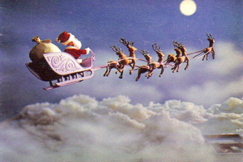 santa and his reindeers in the sky pictures photos and images for