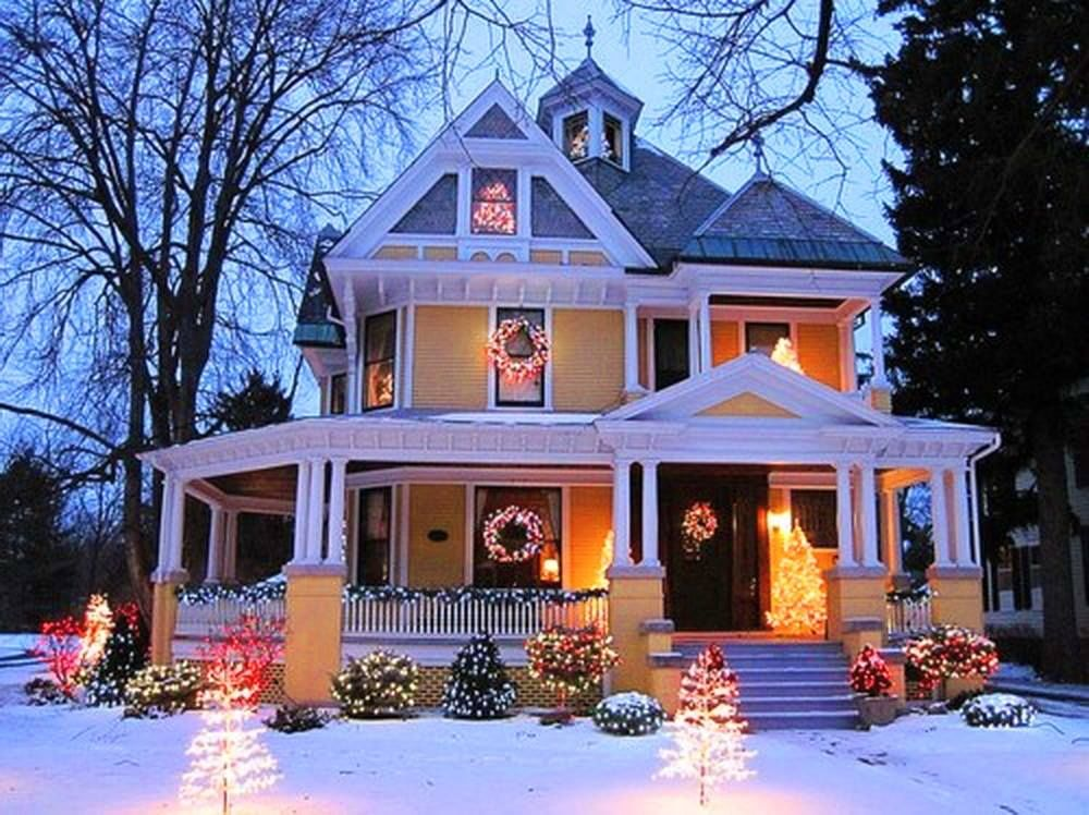 Yellow victorian with outdoor lights pictures photos and for Beautiful home lighting