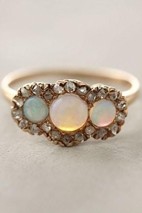 beautiful trio of opals surrounded by diamonds ring