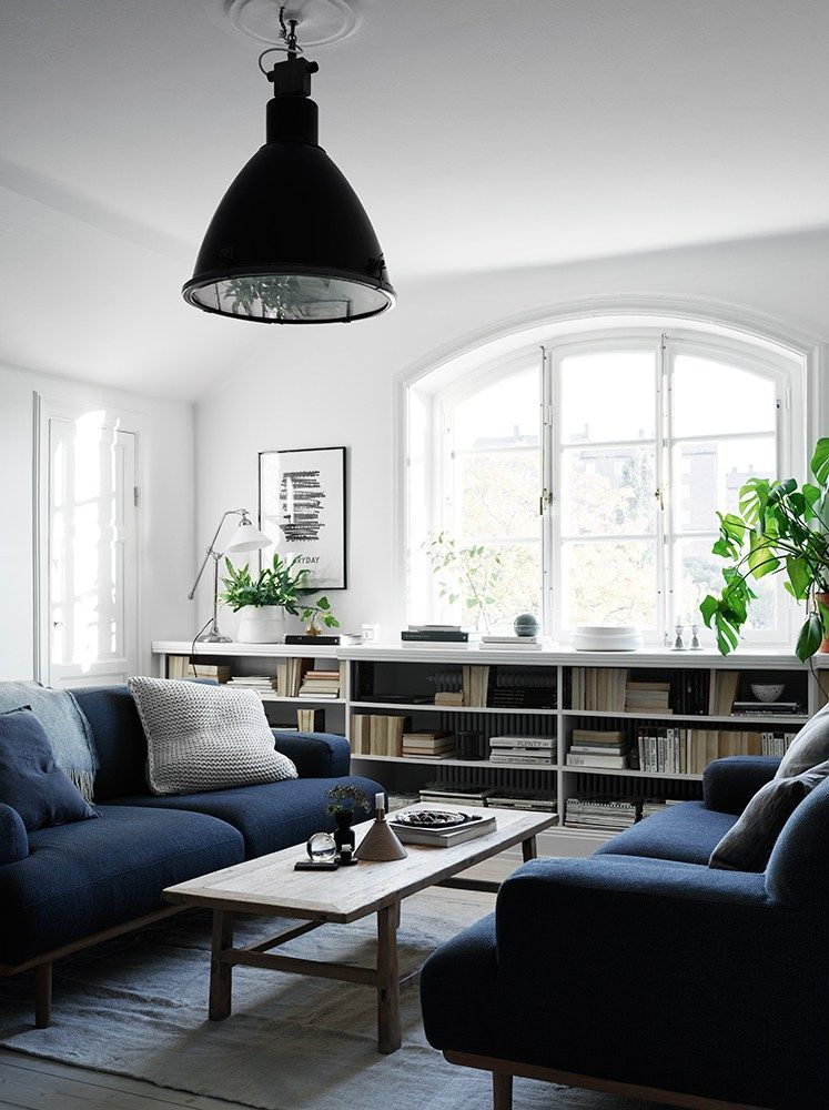 White Living Room With Navy Blue Couch