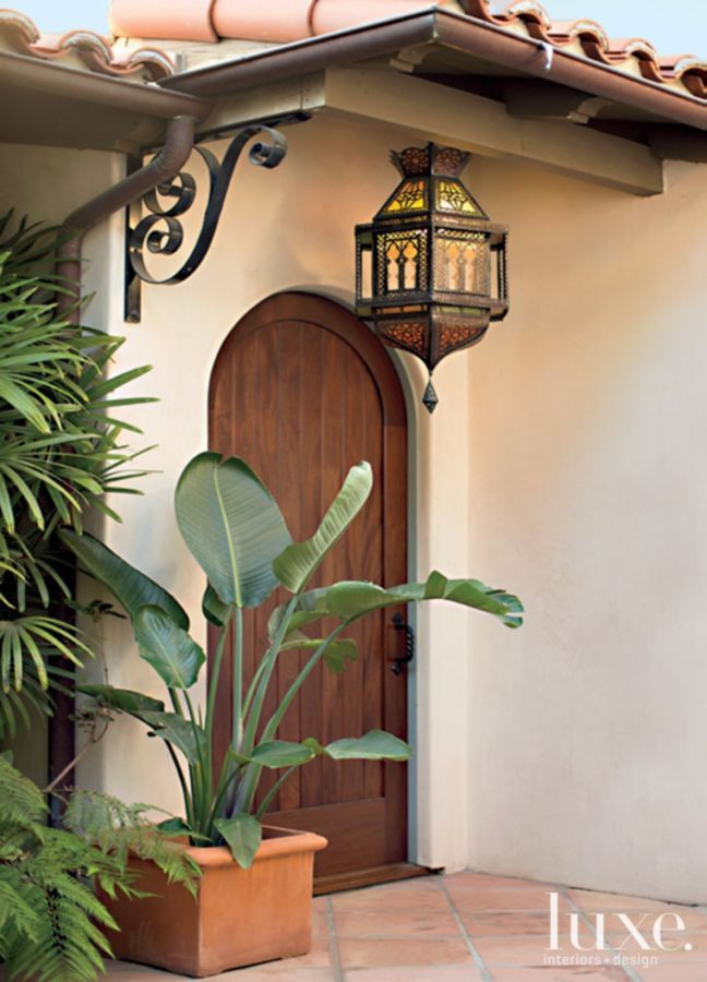 Brown Mediterranean Style Arched Front Door Pictures
