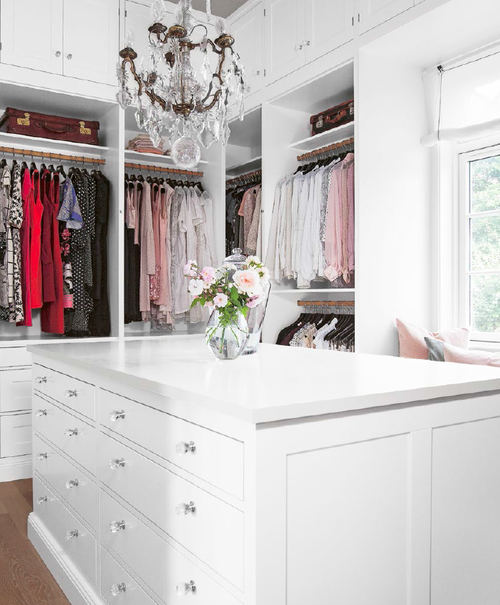 White clean walk in closet