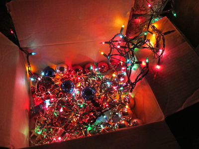 box of christmas lights and ornaments
