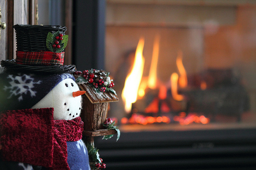 Snowman by the fireplace