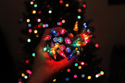 Hand full of colorful christmas lights pictures photos and images