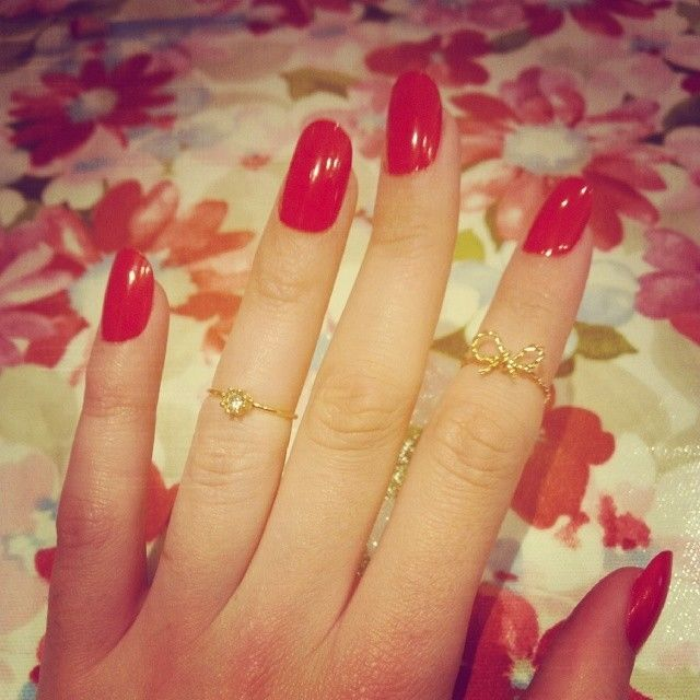 Red nails and pretty rings
