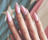 Pink stiletto rhinestone nails