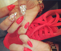 Red stiletto rhinestone nails