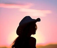 Cowgirl in pink sunset