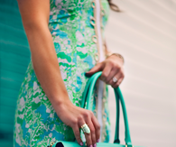 Teal purse and floral dress