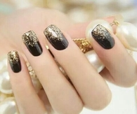 Black nails with golden glitter