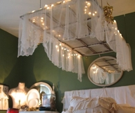 Old Window as a Canopy Above Bed