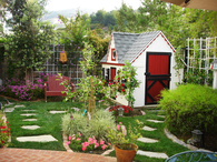 Backyard with Playhouse/Shed & Pavers