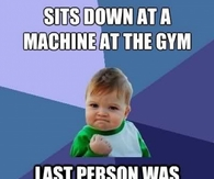 Sits down at a machine at the gym
