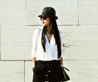 Black & White Skorts Outfit with Strappy Ankle Wrap Sandals and Funky Hat