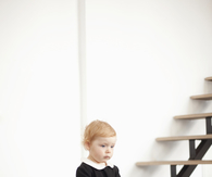 Baby Girl in Old Fashion Black Dress with White Collar