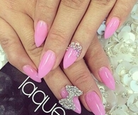 Pink stiletto bow nails