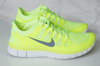 Neon green nike jogging shoes