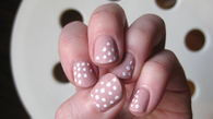 Nude nails with white polkadot nails