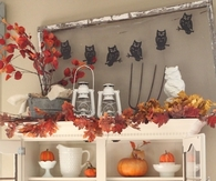 Kitchen Hutch Decorated with Leaves & Pumpkins