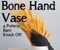 Bone hand vase