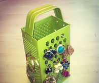 Use graters for jewelry organization