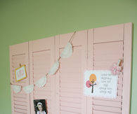 Repurposed shutter wall display
