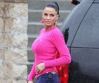 Katie Price in Neon Pink Boots & Sweater