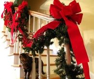 Christmas red ribbons for the banister