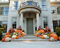 Home with Huge Pumpkins and Gourds Aligning Front Steps