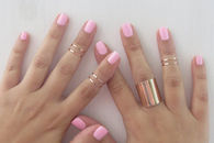 pink nails and jewelry