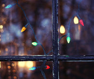 Christmas lights by the window