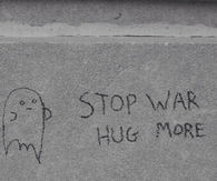 Stop war, hug more