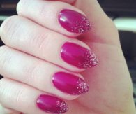 Glitter tipped magenta nails