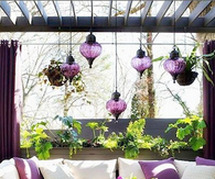 Outdoor Furniture with Purple Accent Hanging Lights