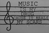 Music is my drug cause it heals my scars