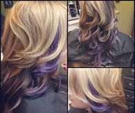 Curly blonde hair with purple peek a boo highlights