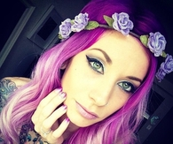 Girl with purple hair and tats