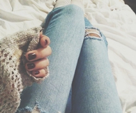 Torn jeans and warm sweater